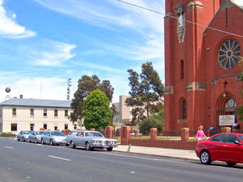 Our vehicles parked outside St Mary's  church, Bairnsdale during a service in 2004.